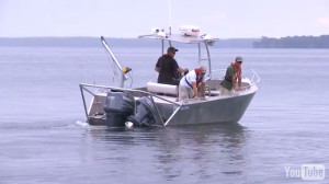 motor boat with 3 men fishing